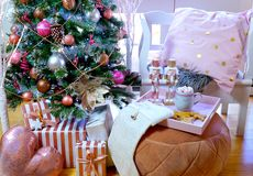 On Trend Pink And Rose Gold Trimmed Christmas Tree With Tray For Santa. Stock Photos