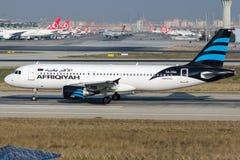 5A-ONA利比亚航空,空中客车A320-214 免版税图库摄影
