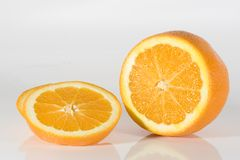Onange. Close-up an orange cut in hafe Stock Images