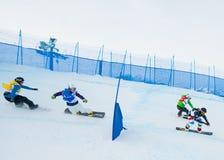 Onbekende snowboarders stock afbeelding
