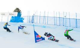 Onbekende snowboarders stock foto's