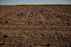 Onbewerkt land, gebied Vuiltextuur De textuur van het het vuilgebied van het land royalty-vrije stock foto