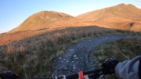 Onboard camera: Mountain biking downhill in stone road in Slate Mountain, Great Britain. View from first person. Perspective POV. 50 fps stock video footage