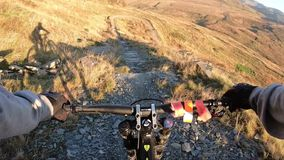 Onboard camera: Mountain biking downhill in stone road in Slate Mountain, Great Britain. View from first person. Perspective POV. 50 fps stock footage