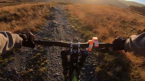 Onboard camera: Mountain biking downhill in stone road in Slate Mountain, Great Britain. View from first person. Perspective POV. 50 fps stock video