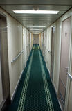 Onboard cruise ship. Onboard, Very Long Corridor of Cruise Ship - Rooms ad Both Sides stock image
