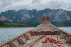 Onboard a longtail boat on Cheow Lan lake. Heading towards the beautiful karst formations along the water Royalty Free Stock Photo