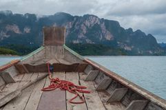 Onboard a longtail boat on Cheow Lan lake. Heading towards the limestone mountains Royalty Free Stock Image