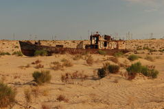 Once the Aral Sea, now a desert. The primary effect of the Aral Sea desiccation has been the significant loss of water in the sea Stock Image