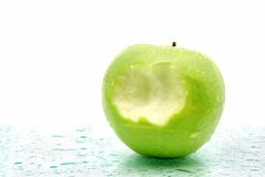 Once bitten. Green apples with a bite mark Stock Image