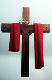 Once upon the cross. A church cross decorateed with a crown of thorns and tapestry Royalty Free Stock Photography