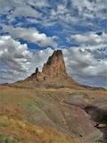 Shiprock Volcanic Peak in New Mexico. Once the inner core of an ancient volcano, Shiprock rises 1,800 above the flat desert surroundings in northwest New Mexico royalty free stock image