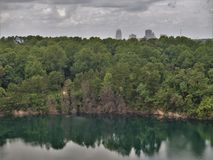 Winston-Salem Skyline from Quarry Park. Once an old granite quarry, the mostly wooded 200 acres was acquired by the city and in 2017 opened as Forsyth County`s royalty free stock image