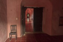 Pink corridors in colonial house. Once a palace for the elite, this is now a museum in Mexico. All corridors and rooms are painted pink Royalty Free Stock Images