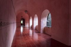 Pink corridors in colonial house. Once a palace for the elite, this is now a museum in Mexico. All corridors and rooms are painted pink Royalty Free Stock Image
