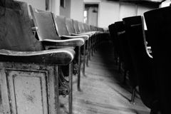 Once There Was An Audience. Auditorium seats of an abandone high school Royalty Free Stock Images