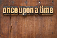 Once upon a time opening phrase. Storytelling concept - vintage letterpress wood type text against grunge weathered wooden background Stock Images