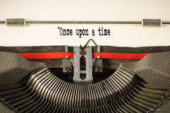 'once upon a time' phase on paper in vintage typewriter Stock Photography