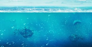 Сoncept Of Global Pollution. In The Open Ocean Floating Trash B Royalty Free Stock Image
