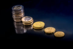 Oncept of stacks Euro Coins. Concept of stacks Euro Coins  on black background Royalty Free Stock Photo