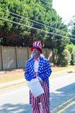 Oncle Sam dans le quatrième du défilé de juillet Image stock