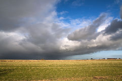 Oncoming bad weather. Meadow with a cloudy sky where you can see the bad weather coming stock photos