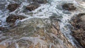 Oncoming sea waves washing seaside resort stone beach. Oncoming sea waves with foam washing seaside resort stone beach, top view. Splash of ground swell stock video footage