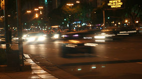 Oncoming traffic, night, blurred headlights. Avenue of 9th July,Buenos  Aires,Argentina Royalty Free Stock Image