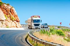 Oncoming traffic truck and car in mountains Royalty Free Stock Images