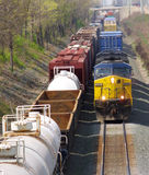 Oncoming train. Oncoming freight train passing a parked train stock photos