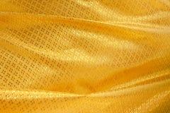 Onda de la materia textil amarilla Imagen de archivo