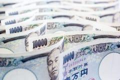 Onda del dinero Yen Banknote On White Background imagenes de archivo
