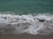 Onda del mar - la tormenta comienza fotos de archivo libres de regalías