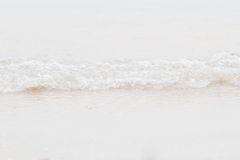 Onda do close up na praia Imagem de Stock