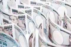 Onda do dinheiro Yen Banknote On White Background imagens de stock royalty free