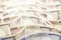 Onda do dinheiro Yen Banknote On White Background foto de stock