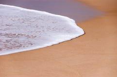 Onda e areia Foto de Stock