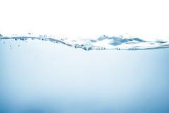 Onda e bolle di acqua blu Fotografia Stock