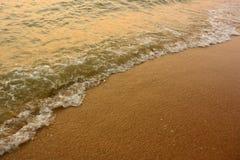 Onda e a praia Imagem de Stock