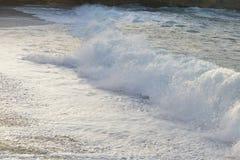 Onda e sabbia del mare Fotografie Stock