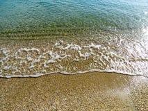 Onda molle del mare sulla spiaggia di sabbia per fondo Fotografia Stock
