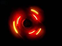 Onda porpora rosa del cerchio nel fondo scuro Fotografia Stock