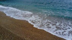Onda y playa del mar fotos de archivo
