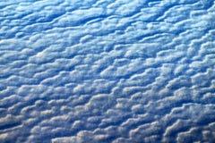 Ondas azules del fondo de la foto de la nieve Fotos de archivo libres de regalías