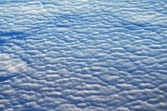 Ondas azules del fondo de la foto de la nieve Imágenes de archivo libres de regalías