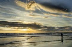 Ondas de la puesta del sol Fotos de archivo
