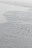 Ondas de plata de la orilla Imagen de archivo
