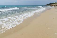 Ondas e areia Fotografia de Stock Royalty Free
