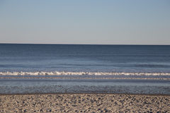 Ondas na praia Imagem de Stock