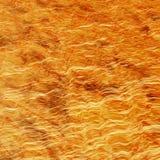 Onde dell'estratto dell'oro Fotografie Stock